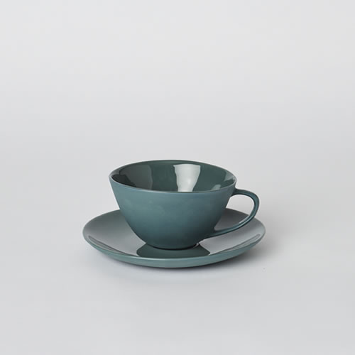 Tea Cup and Saucer in Bottle