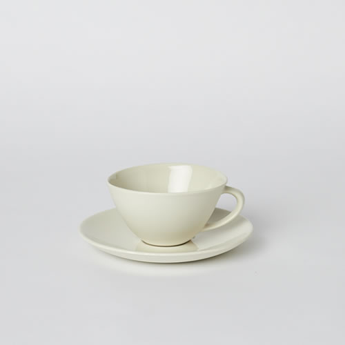 Tea Cup and Saucer in Milk