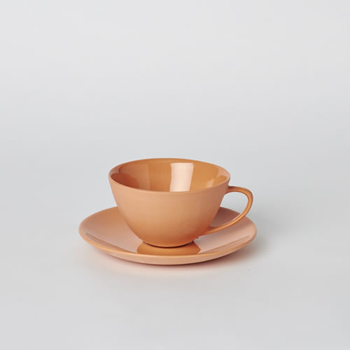 Tea Cup and Saucer in Orange